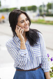 Beautiful young brunette woman calling by phone Stock Photo