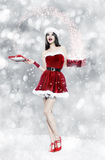 Beautiful young brunette woman with christmas gift Stock Photo
