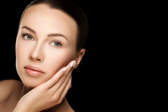 Beautiful young brunette woman with clean fresh skin with nude m Royalty Free Stock Images