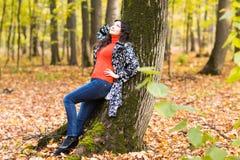 Beautiful young brunette woman - colorful autumn portrait Stock Photo