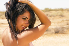 Beautiful young brunette woman in the desert Stock Image
