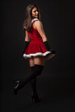 Beautiful young brunette woman dressed as Santa Stock Photos