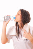 Beautiful young brunette woman drinking water Stock Photos