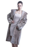 Woman wearing dress and long fur coat Royalty Free Stock Photos