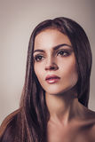 Beautiful young brunette woman glamour portrait Close up face Long hair Stock Photo