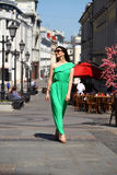 Beautiful young brunette woman in green long dress Royalty Free Stock Photo