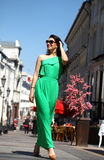 Beautiful young brunette woman in green long dress Royalty Free Stock Photography