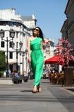Beautiful young brunette woman in green long dress Stock Photos