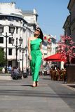 Beautiful young brunette woman in green long dress Royalty Free Stock Image