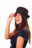 Beautiful young brunette woman in a hat Stock Photo