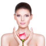 Beautiful young brunette woman with healthy skin. Royalty Free Stock Image