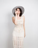 Beautiful young brunette woman holding a broad-brimmed hat, she expression of different emotions. Beautiful young brunette woman holding a broad-brimmed hat Royalty Free Stock Photos