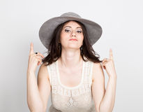 Beautiful young brunette woman holding a broad-brimmed hat. girl flirting concept. expression of different emotions.  Stock Photo