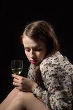 Beautiful young brunette woman holding a glass of white wine Stock Image
