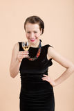 Beautiful young brunette woman holding a glass of white wine Royalty Free Stock Image