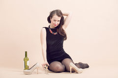 Beautiful young brunette woman holding a glass of white wine Stock Photo