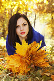 Beautiful young brunette woman with leaves Stock Photography
