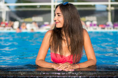 Beautiful young brunette woman with long hair in pink bikini kee Stock Photography