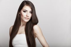 Beautiful young brunette woman with long hair Stock Photos