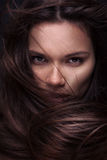 Beautiful young brunette woman with long straight hair Royalty Free Stock Photo
