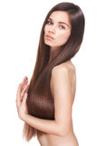 Beautiful young brunette woman with long straight. Hair posing isolated on white background. Beauty face with closed eyes. This image has attached release Royalty Free Stock Image