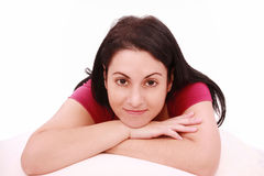 Beautiful young brunette woman lying on the bed Royalty Free Stock Photo