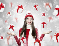 Beautiful young brunette woman with many gifts - christmas portr. Beautiful young brunette woman with many gifts on silver background - christmas portrait Royalty Free Stock Photo