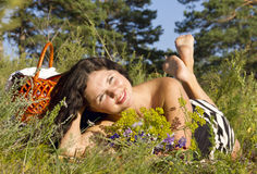 Beautiful young brunette woman on the meadow Stock Photography
