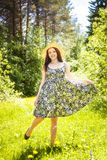 Beautiful young brunette woman on the meadow Royalty Free Stock Images