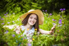 Beautiful young brunette woman on the meadow Stock Image