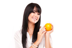 Beautiful young brunette woman with orange on white background Royalty Free Stock Image