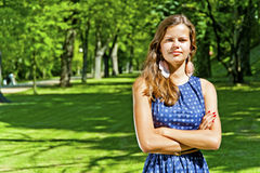 Beautiful young brunette woman outdoor on the meadow on a summer Royalty Free Stock Photo