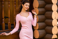 Beautiful young brunette woman in pink dress Royalty Free Stock Photos