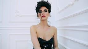 Beautiful young brunette woman posing