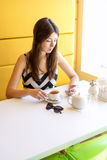 Beautiful young brunette woman in a room cafe Stock Photography