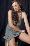Beautiful young brunette woman sitting Stock Image