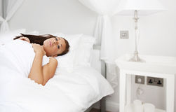 Beautiful young brunette woman sleeping Royalty Free Stock Image