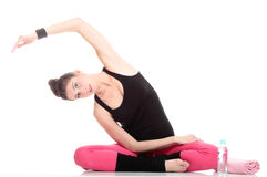 Beautiful young brunette woman stretching muscles arms isolated Stock Photo