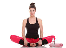 Beautiful young brunette woman stretching muscles arms isolated Royalty Free Stock Photo