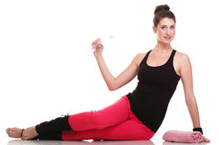 Beautiful young brunette woman stretching muscles arms isolated Royalty Free Stock Photography