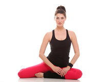 Beautiful young brunette woman stretching muscles arms isolated Stock Images