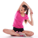 Beautiful young brunette woman stretching Stock Image
