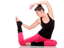 Beautiful young brunette woman stretching muscles arms  Stock Photo