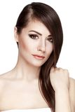 Beautiful young brunette woman touches her hair Royalty Free Stock Image