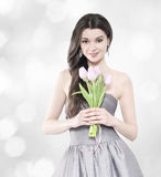 Beautiful brunette woman with tulip bouquet. Beautiful young brunette woman with tulip bouquet. Elegant portrait stock photos