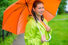 Beautiful young brunette woman with an   umbrella Stock Photo