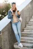Beautiful young brunette woman wearing jacket stock photography