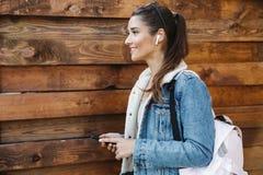 Beautiful young brunette woman wearing jacket royalty free stock image