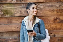 Beautiful young brunette woman wearing jacket stock image