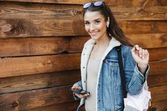 Beautiful young brunette woman wearing jacket royalty free stock photography